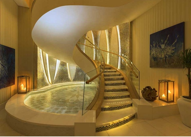 The elaborate winding staircase guests arrive at the master bedroom - Inside Abu Dhabi S Largest Hotel Suite Legatto Lifestyle