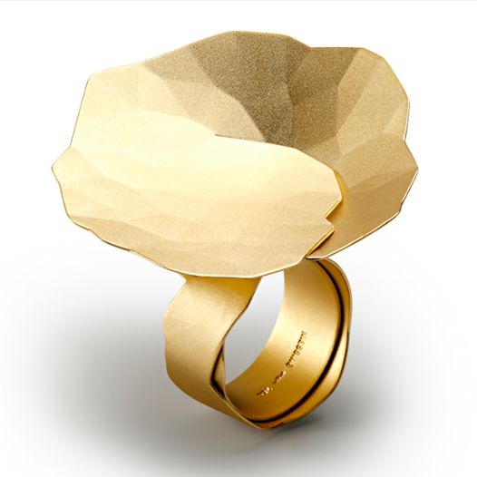 """Lauded for its groundbreaking design and quality, the """"Topia"""" collection by Niessing (Germany), presented by Lee Hwa Jewellery, features a round flat disk of precious metal folded by hand, to create a slender, 3D form. The pleating starts in the center and slants the disk inward at an angle of 45 degrees."""